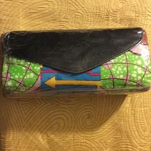 Handbags - Authentic African print clutchw/ faux leather flap
